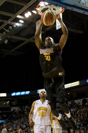 john labatt centre: London Ontario, Canada - January 7, 2012. Eric Crookshank (20) of the Halifax Rainmen completes a dunk during a National Basketball League of Canada game between the London Lightning and the Halifax Rainmen. The Rainmen were forced to wear the Lightning`s Editorial