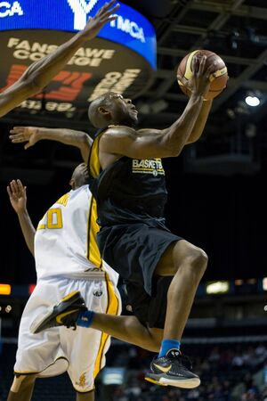 London Ontario, Canada - January 7, 2012. A Halifax Rainmen player goes up for a basket during a National Basketball League of Canada game between the London Lightning and the Halifax Rainmen. The Rainmen were forced to wear the Lightning`s practice jerse