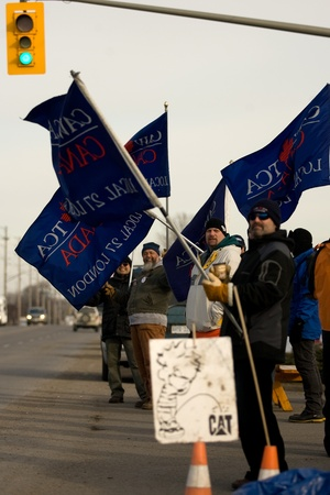 London Ontario, Canada - January 9, 2012. Locked out Electro Motive workers walk the picket line in front of the factory located in London. The company, owned by Caterpillar locked out more than 700 union and non-union workers on January 1, 2012 at the Ca Stock Photo - 13118949