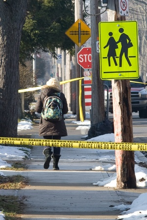 London Ontario, Canada - January 11, 2012.  London police have portions of Grey Street sectioned off after two individuals were shot outside a house that is believed to be a Hells Angels clubhouse. Police are not commenting on any association between the  Stock Photo - 13118988