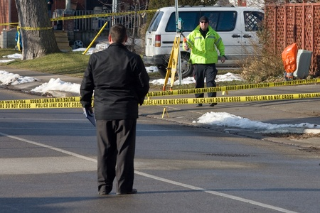 sectioned: London Ontario, Canada - January 11, 2012.  London police have portions of Grey Street sectioned off after two individuals were shot outside a house that is believed to be a Hells Angels clubhouse. Police are not commenting on any association between the