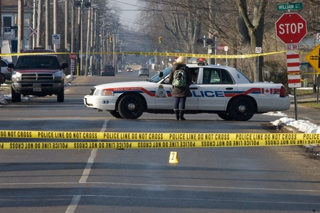 London Ontario, Canada - January 11, 2012.  London police have portions of Grey Street sectioned off after two individuals were shot outside a house that is believed to be a Hells Angels clubhouse. Police are not commenting on any association between the