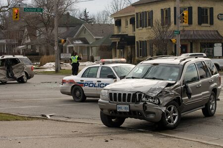 London Ontario, Canada - January 11, 2012. Two vehicles sit in the intersection of Oxford and Waterloo Streets.  The vehicle in the foreground is believed to be the same one used in four seperate bank robberies that took place in quick succession of each  Stock Photo - 13140764
