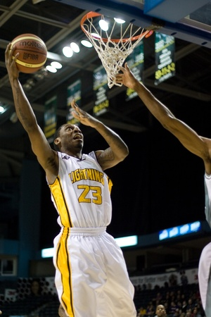 john labatt centre: London Ontario, Canada - January 12, 2012. Tim Ellis (23) goes up for a basket as the 16-4 London Lightning hosted the 4-16 Moncton Miracles in a regular season National Basketball League of Canada game at the John Labatt Centre. London won the game. ?? t