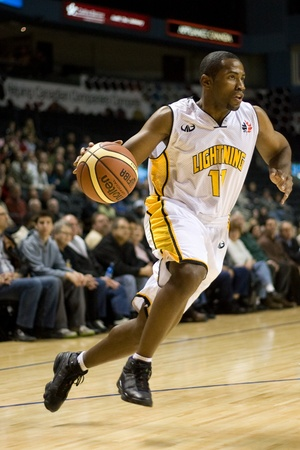 london lightning: London Ontario, Canada - January 12, 2012. in a regular season National Basketball League game between the London Lightning and Moncton Miracles. London won the game 124 -113 extending their record to 17 - 4 which is good enough for first place in the lea