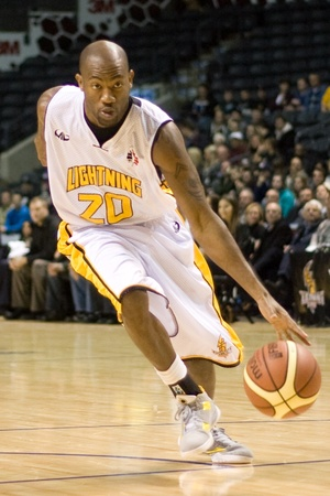 john labatt centre: London Ontario, Canada - January 12, 2012. Eddie Smith (20) of the London Lightning drives to the basket in a regular season National Basketball League game between the London Lightning and Moncton Miracles. London won the game 124 -113 extending their re Editorial