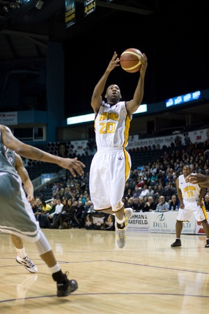 john labatt centre: London Ontario, Canada - January 12, 2012. Eddie Smith (20) of the London Lightning goes up for a basket as the 16-4 London Lightning hosted the 4-16 Moncton Miracles in a regular season National Basketball League of Canada game at the John Labatt Centre. Editorial