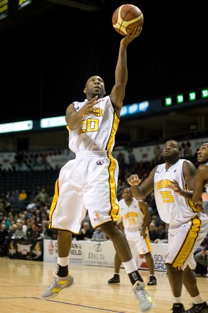 London Ontario, Canada - January 12, 2012. Eddie Smith (20) of the London Lightning goes up for shot in a regular season National Basketball League game between the London Lightning and Moncton Miracles. London won the game 124 -113 extending their record