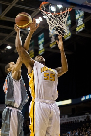London Ontario, Canada - January 12, 2012. Braxton Dupree (55) of the London Lightning goes up for a basket against Terrence Woodyard in a regular season National Basketball League game between the London Lightning and Moncton Miracles. London won the gam Editorial