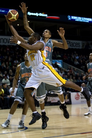 layup: London Ontario, Canada - January 12, 2012. Brandon Dean (11) of the London Lightning goes for a layup but is fouled by Darrell Wonge of the Moncton Miracles. The 16-4 London Lightning hosted the 4-16 Moncton Miracles in a regular season National Basketbal Editorial