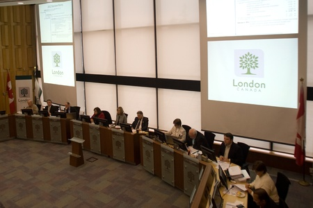 London Ontario, Canada - January 18, 2012.  Members of the Servcies Review Committee begins the long process of pouring over the `addcut` list looking for opporunties to trim the city budget for 2012.  Mayor Joe Fontana ran on a platform of a zero percen Editorial