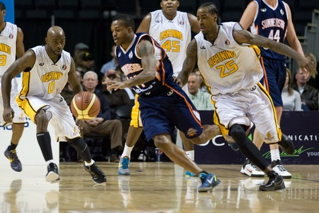 john labatt centre: London Ontario, Canada - January 6, 2012. Stephen McDowell (11) of the Summerside Storm eludes Gabe Freeman (25) and DeAnthony Bowden (0) of the London Lightning in a National Baskeball League of Canada game between the London Lightning and the Summerside