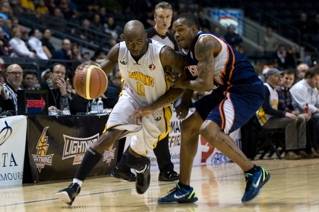 john labatt centre: London Ontario, Canada - January 6, 2012. DeAnthony Bowden (0) of the London Lightning cuts around a Summerside Storm player in a National Baskeball League of Canada game between the London Lightning and the Summerside Storm. London won the game 106-98. Editorial