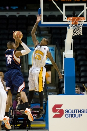 john labatt centre: London Ontario, Canada - January 6, 2012. Gabe Freeman (25) of the London Lightning goes up to block a shot in a National Baskeball League of Canada game between the London Lightning and the Summerside Storm. London won the game 106-98.