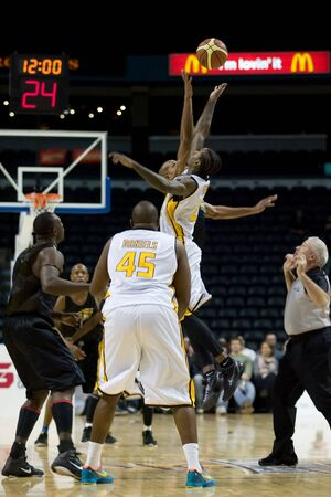 halifax rainmen: London Ontario, Canada - January 7, 2012. The opening tipoff during a National Basketball League of Canada game between the London Lightning and the Halifax Rainmen. The Rainmen were forced to wear the Lightning`s practice jerseys when the Halifax teams g