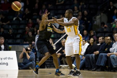 halifax rainmen: London Ontario, Canada - January 7, 2012. Brandon Dean (11) makes a pass during a National Basketball League of Canada game between the London Lightning and the Halifax Rainmen. The Rainmen were forced to wear the Lightning`s practice jerseys when the Hal Editorial
