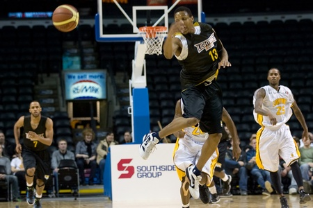 halifax rainmen: London Ontario, Canada - January 7, 2012. Joey Haywood (13) of the Halifax Rainmen makes a pass during a National Basketball League of Canada game between the London Lightning and the Halifax Rainmen. The Rainmen were forced to wear the Lightning`s practi