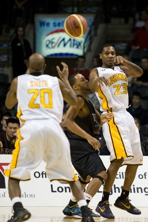 halifax rainmen: London Ontario, Canada - January 7, 2012. Tim Ellis (23) of the London Lightning makes a pass to Eddie Smith (20) during a National Basketball League of Canada game between the London Lightning and the Halifax Rainmen. The Rainmen were forced to wear the