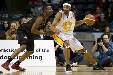 London Ontario, Canada - January 7, 2012. Rodney Burford (30) of the London Lightning works against a Halifax Rainmen player during a National Basketball League of Canada game between the London Lightning and the Halifax Rainmen. The Rainmen were forced t