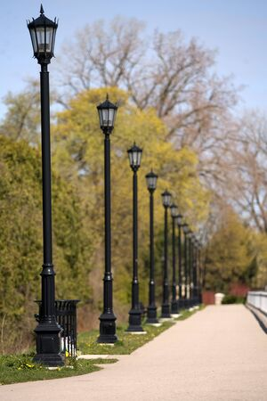 London Ontario, Canada - April 12, 2012. A row of lamp standards along a pathway in London Ontario, Canada.