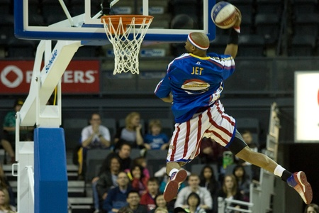 London Ontario, Canada - April 14, 2012. John (Jet) Williams (32) goes up for slam dunk during the warm up. The Harlem Globetrotters brought their show and defeated the International Elite to win the World Championship at the John Labatt Centre in Londo Editorial
