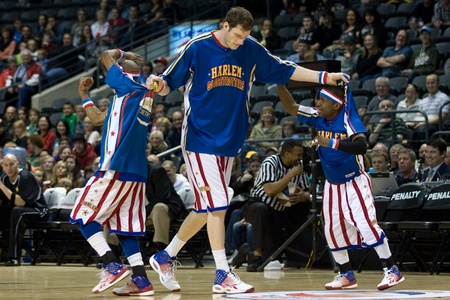 john labatt centre: London Ontario, Canada - April 14, 2012. Paul (Tiny) Sturgess, centre helps Jonte (Too Tall) Hall and Tay (Firefly) Fisher off of the court at the start of the show.  The Harlem Globetrotters brought their show and defeated the International Elite to win