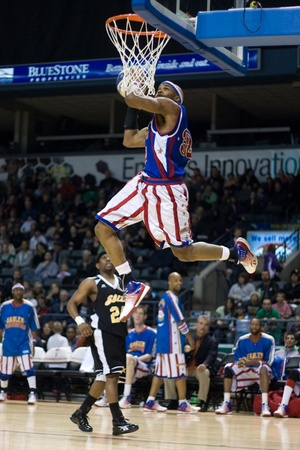 London Ontario, Canada - April 14, 2012. John (Jet) Williams (32) goes up for a slam dunk during the show. The Harlem Globetrotters brought their show and defeated the International Elite to win the World Championship at the John Labatt Centre in London Editorial