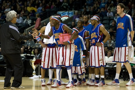 London Ontario, Canada - April 14, 2012. Kevin (Special K) Daley (21) reacts to a fan during the show. The Harlem Globetrotters brought their show and defeated the International Elite to win the World Championship at the John Labatt Centre in London Ont Editorial