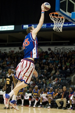 7 8: London Ontario, Canada - April 14, 2012. Paul (Tiny) Sturgess (55) at 7 8 is the tallest player to ever play professional basketball and was reconized as such on November 17, 2011 by the Guinness Book of World Records. The Harlem Globetrotters brought t