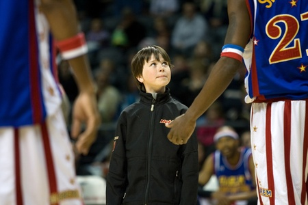 London Ontario, Canada - April 14, 2012. A young fan listens to what he has to do to win a team jersey. The Harlem Globetrotters brought their show and defeated the International Elite to win the World Championship at the John Labatt Centre in London On