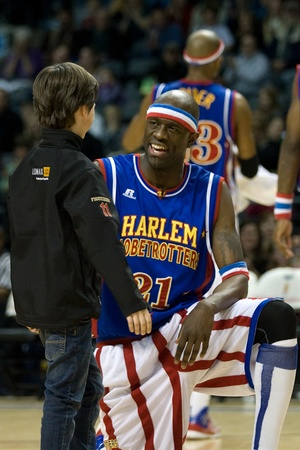 London Ontario, Canada - April 14, 2012. Kevin (Special K) Daley (21) talks to a young fan during their show. The Harlem Globetrotters brought their show and defeated the International Elite to win the