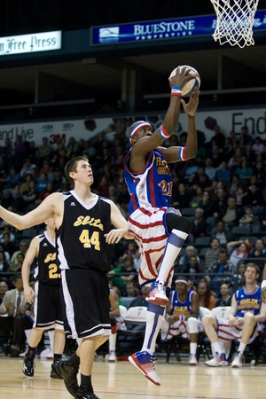 London Ontario, Canada - April 14, 2012. Kevin (Special K) Daley (21) of the Harlem Globetrotters goes up for a basket. The Harlem Globetrotters brought their show and defeated the International Elite to win the World Championship at the John Labatt Cen Editorial