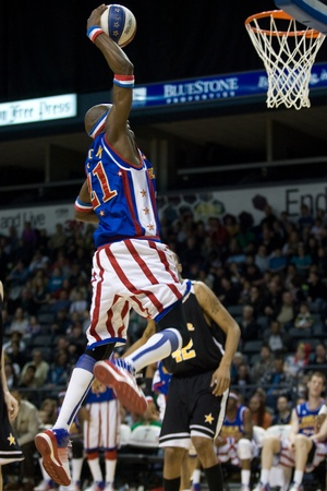john labatt centre: London Ontario, Canada - April 13, 2012. Kevin Special K Daley (21) of the Harlem Globetrotters goes up for a basket. The London Knights defeated the Saginaw Spirit 2 - 1 in overtime at the John Labatt Centre taking a three to two series lead.  Editorial