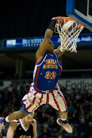 London Ontario, Canada - April 14, 2012. John Jet Williams (32) of the Harlem Globetrotters completes a slam dunk during their game. The Harlem Globetrotters brought their show and defeated the International Elite to win the World Championship at the  Editorial