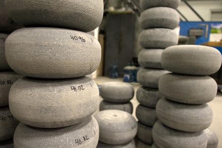 April 26, 2012. Partially completed curling rocks sit waiting to be finished. The numbers on side of the rocks indicated the weight of the rocks in pounds. Canada Curling Stone in Komoko Ontario, near London is one of two companies in the world that refin Stock Photo - 13455879