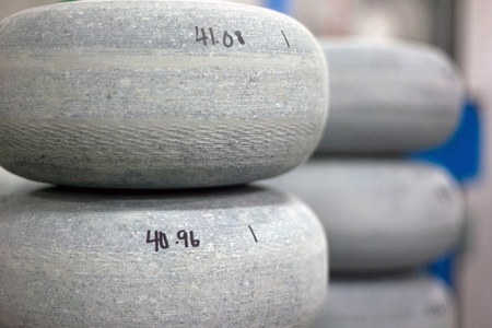 April 26, 2012. Partially completed curling rocks sit waiting to be finished. Canada Curling Stone in Komoko Ontario, near London is one of two companies in the world that refinish curling stones.  The company was founded in 1987 and by the early 1990s wa Stock Photo - 13455876