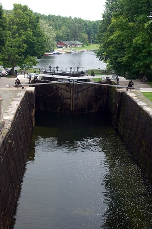public sector: August 9, 2010. A lock on the Trent-Severn waterway in Eastern Ontario. The Trent-Severn waterway is operated by Parks Canada and may experience reduced operating hours in 2012 as a result of the job cuts to the public sector initiated by the Harper Gover Editorial