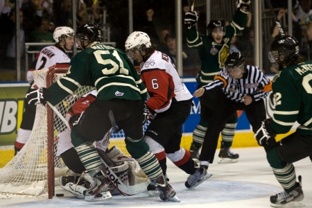 London Ontario, Canada - May 11, 2012. Austin Watson (51) of the London Knights jams the puck past Niagara Icedog goalie Mark Visentin in the first period. The London Knights defeated the Niagara Icedogs 2 -1 to win the Ontario Hockey League Championship  Editorial