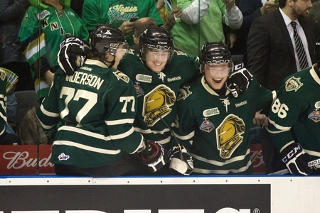 London Ontario, Canada - May 11, 2012. From left to right Josh Anderson, Chris Tierney and Max Domi of the London Knights celebrate after Seth Griffith scores in the third period. The London Knights defeated the Niagara Icedogs 2 -1 to win the Ontario Hoc