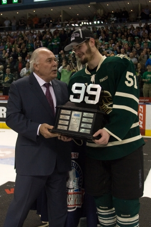 commissioner: London Ontario, Canada - May 11, 2012. Austin Watson, right is present the trophy for being the Playoff Most Valuable Player by Ontario Hockey League commissioner David Branch. The London Knights defeated the Niagara Icedogs 2 -1 to win the Ontario Hockey Editorial