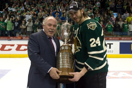 accepts: London Ontario, Canada - May 11, 2012. Jarred Tinordi (24) captain of the London Knights accepts the J. Ross Robertson trophy from Ontario Hockey League commissioner David Branch. The London Knights defeated the Niagara Icedogs 2 -1 to win the Ontario Hoc