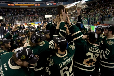 London Ontario, Canada - May 11, 2012. Members of the London Knights hold the J. Ross Richardson trophy aloft. The London Knights defeated the Niagara Icedogs 2 -1 to win the Ontario Hockey League Championship series 4 - 1. The Knights will now play for t