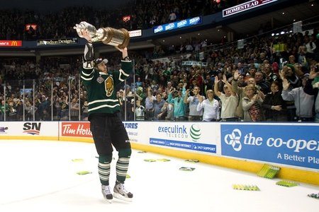 john labatt centre: London Ontario, Canada - May 11, 2012. Jarred Tinordi, captain of the London Knights takes the J. Ross Richardson trophy for a victory lap in front of more than 9,000 fans at the John Labatt Centre. The London Knights defeated the Niagara Icedogs 2 -1 to  Editorial