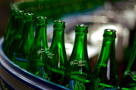 brewery: Toronto Ontario, Canada - June 5, 2012. Bottle of Steam Whistle beer move along the production line at the companies roundhouse brewery in Toronto Ontario, Canada.