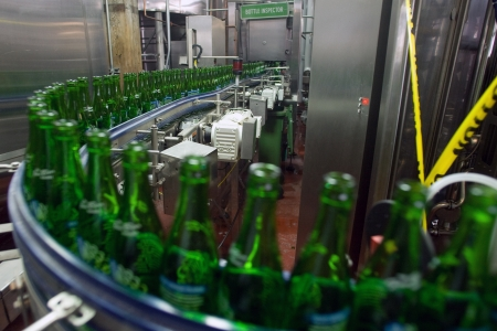 brewery: Toronto Ontario, Canada - June 5, 2012. Sterilized bottles move along the production line at the Steam Whistle Brewery in Toronto Ontario, Canada.  Editorial