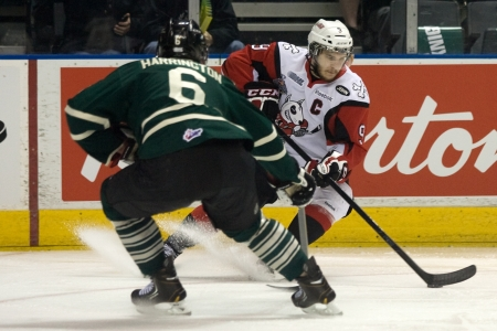 London Ontario, Canada - May 11, 2012. Andrew Agozzino (9) of the Niagara Icedogs tries to get around London Knight defenceman Scott Harrington (6). The London Knights defeated the Niagara Icedogs 2 -1 to win the Ontario Hockey League Championship series