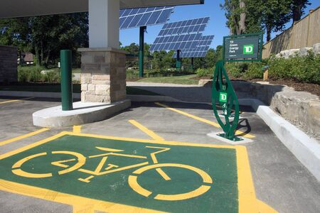 dominion: London, ON – June 26, 2012 – The TD Green Energy Park in London, Ontario. The park powers Canada's first net-zero energy bank branch, which features 244 solar panels and a dual electric car charger for customers.  Editorial