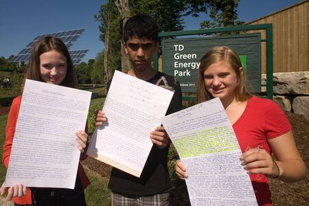 essays: London, ON – June 26, 2012 – Students from Masonville Public School display the essays they wrote on seed paper. The special paper was later planted where it will break down and bloom into a plant. The TD Green Energy Park in London, Ontario. The park pow
