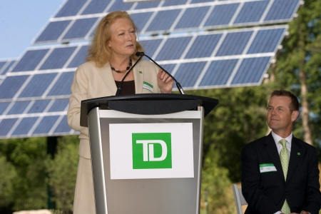 td: London, ON – June 26, 2012 – Karen Clarke-Whistler addresses guests at the opening of TD`s Green Energy Park while Tom Dyck of TD Bank Group listens. The TD Green Energy Park in London, Ontario. The park powers Canada's first net-zero energy bank branch,