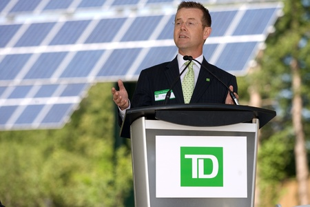 td: London, ON � June 26, 2012 � Tom Dyck of TD Bank Group addresses attendee`s at the opening of TD`s Green Energy Park. The TD Green Energy Park in London, Ontario. The park powers Canada�s first net-zero energy bank branch, which features 244 solar panels  Editorial